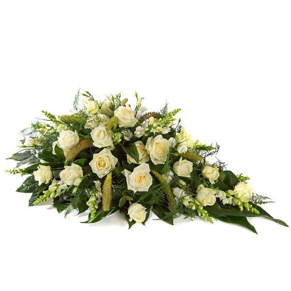 Traditioneel wit rouwbloemstuk, afscheidsbloement
