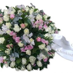 A classic funeral flower arrangement in pink and white