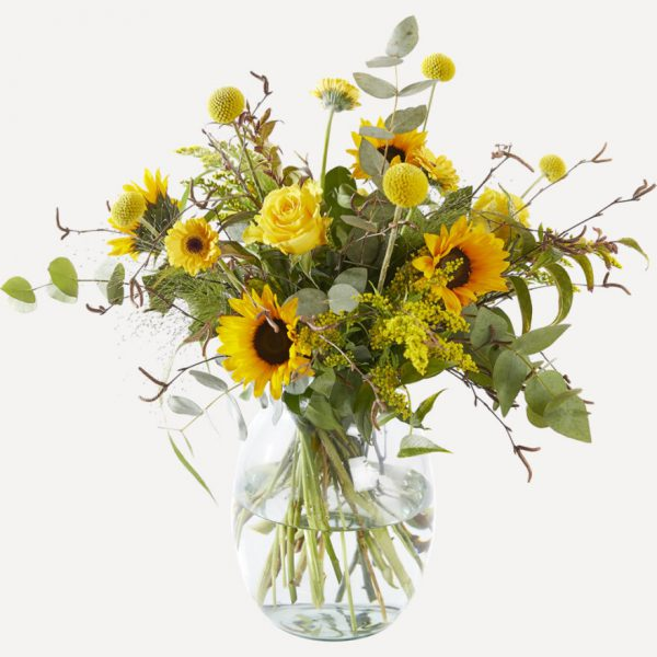 Trendy yellow bouquet with sunflowers with vase