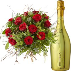 A bouquet of lovely red roses and a bottle Prosecco