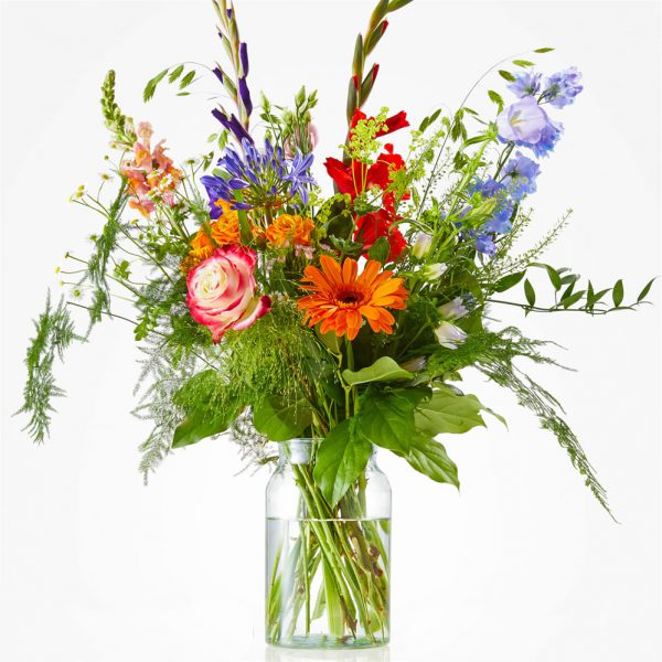 Cheerful and colorful picking bouquet of summer flowers